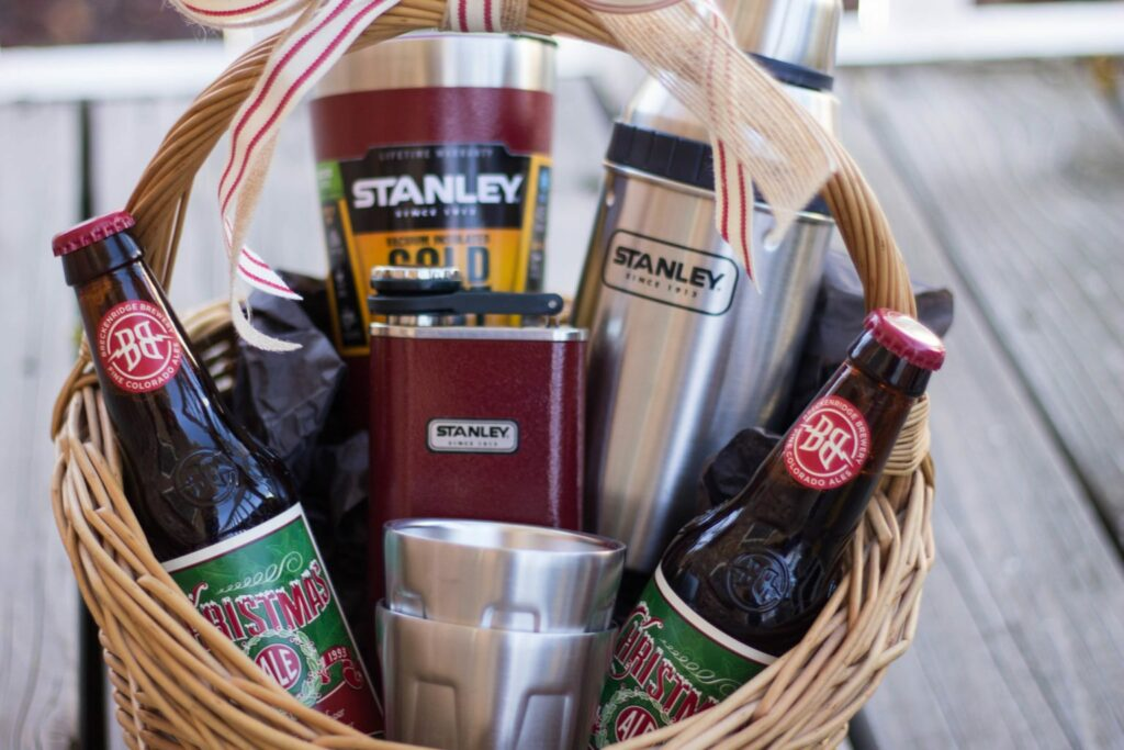 Give the gift of cheer this season! And by Cheer, I mean Cheers! This basket full of beer and all the Stanley Brand gear you need for drinks in the mountains is a great DIY gift for the beer lover or whisky fan in your family!