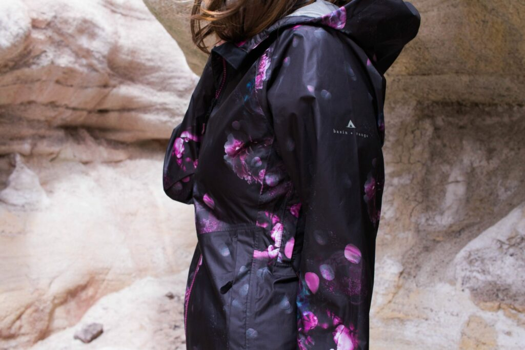 SO in love with that fun Floral print rain jacket from Basin & Range! Also that location is stunning - Paint Mines in Colorado!
