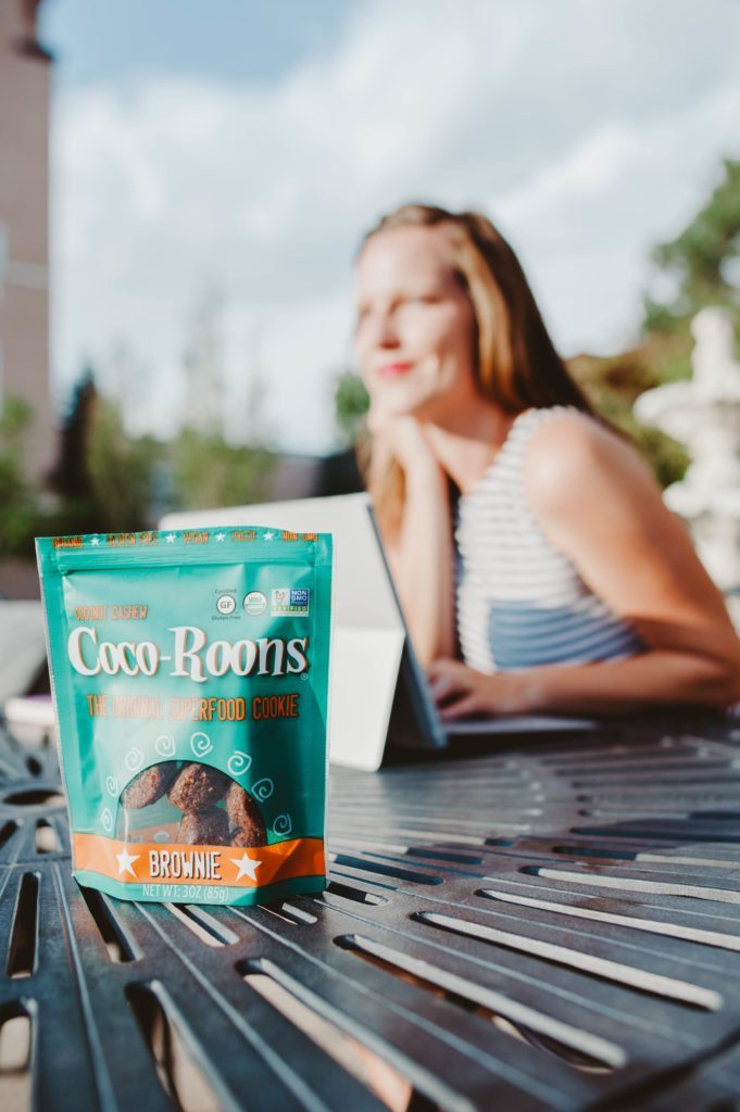 Girl Boss Elizabeth Mayberry of Oak + Oats working and snacking on Coco-Roons!